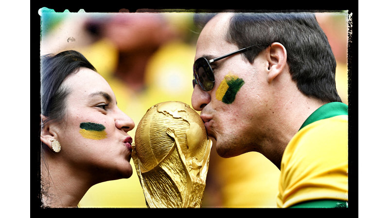 3/38 Brazil fans kiss the World Cup, Brazilia, Brazil 2014