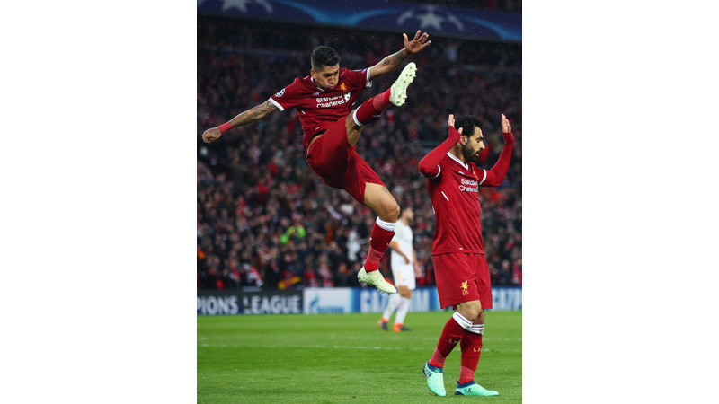 24/161 Salah and Firmino celebrate against Roma, 2018