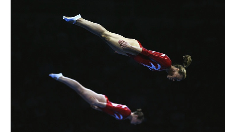 143/161 - Flying Gymnasts in Beijing - China, 2008. © Getty Images