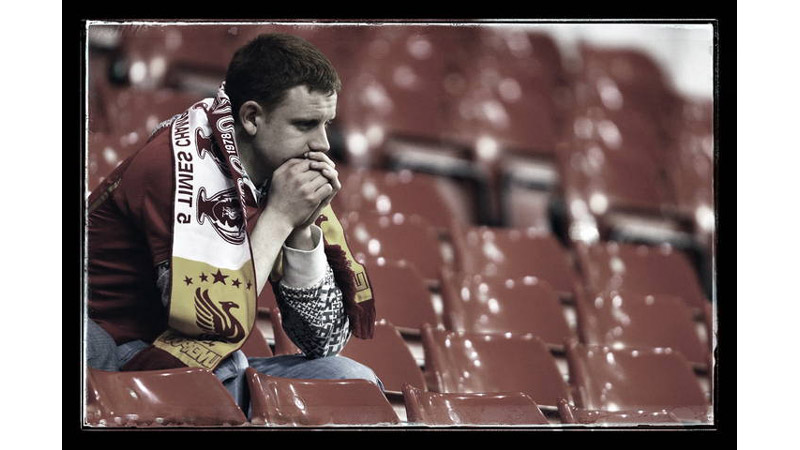 9/38 A dejected Liverpool fan, Anfield, England 2010